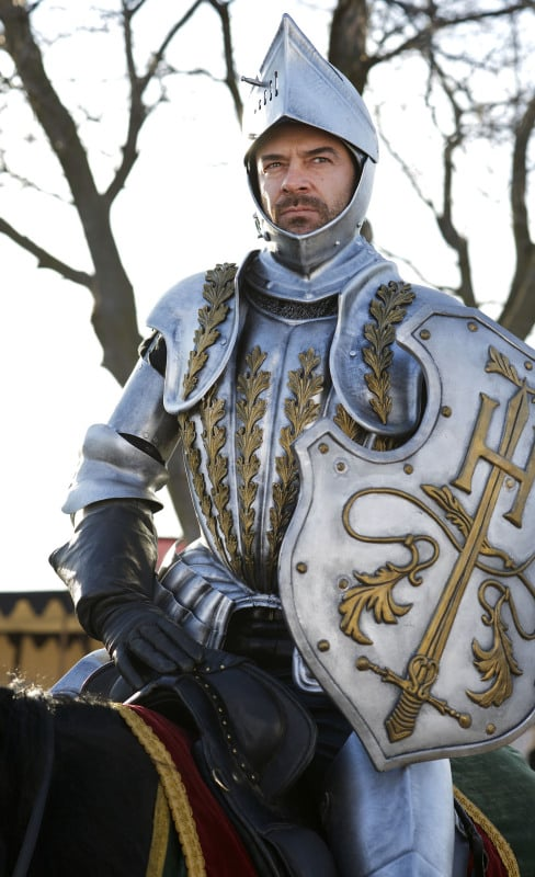 King Henry (Alan Van Sprang) suits up as a knight.