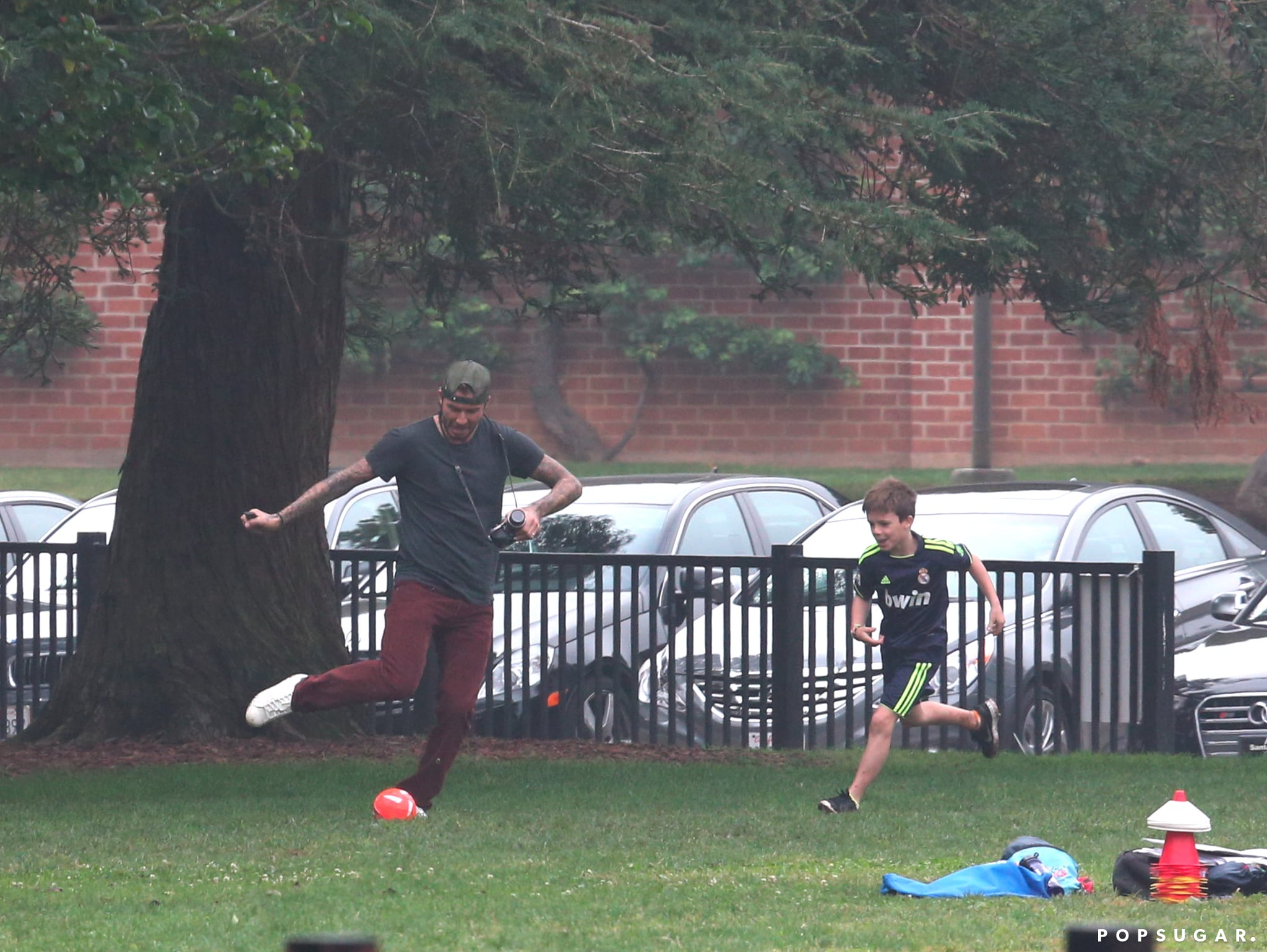 David Beckham played soccer with his son Cruz when the group went to Harper's game.