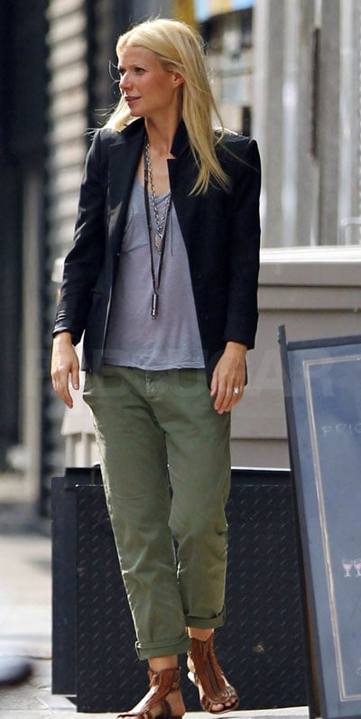 Gwyneth is in full Summer mode in Current/Elliot chinos, a loose gray tank, and a cool blazer. Her brown leather gladiators are a down-to-earth touch.