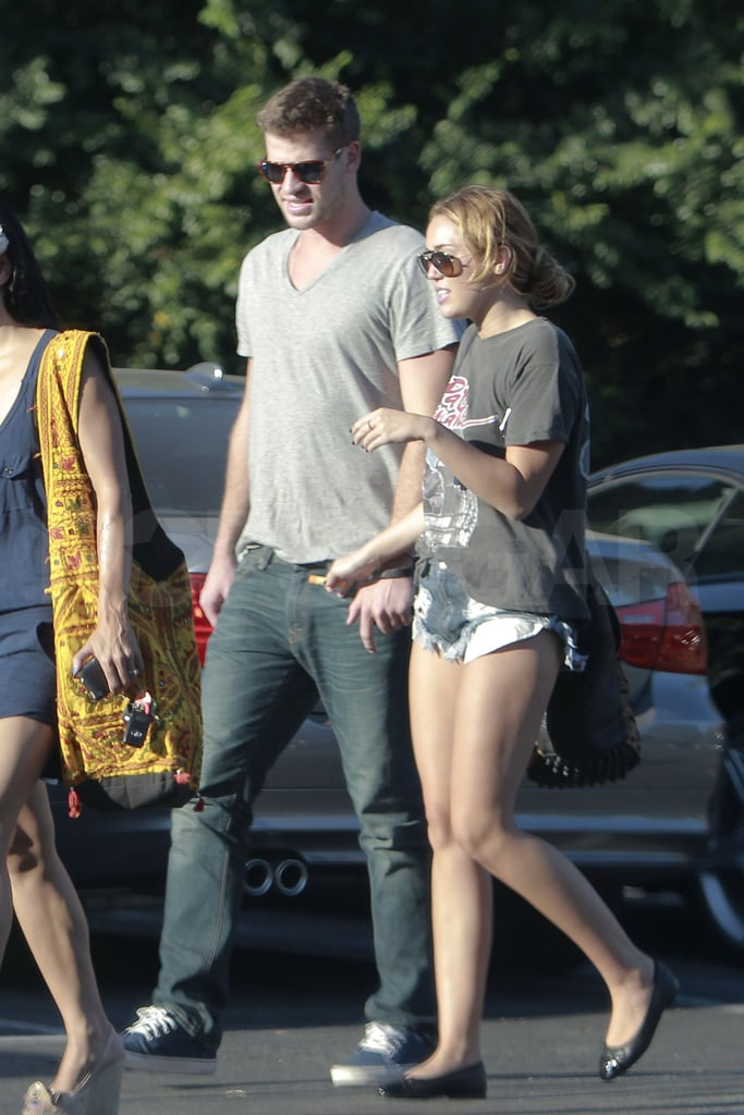 Miley and Liam chatted as they walked.
