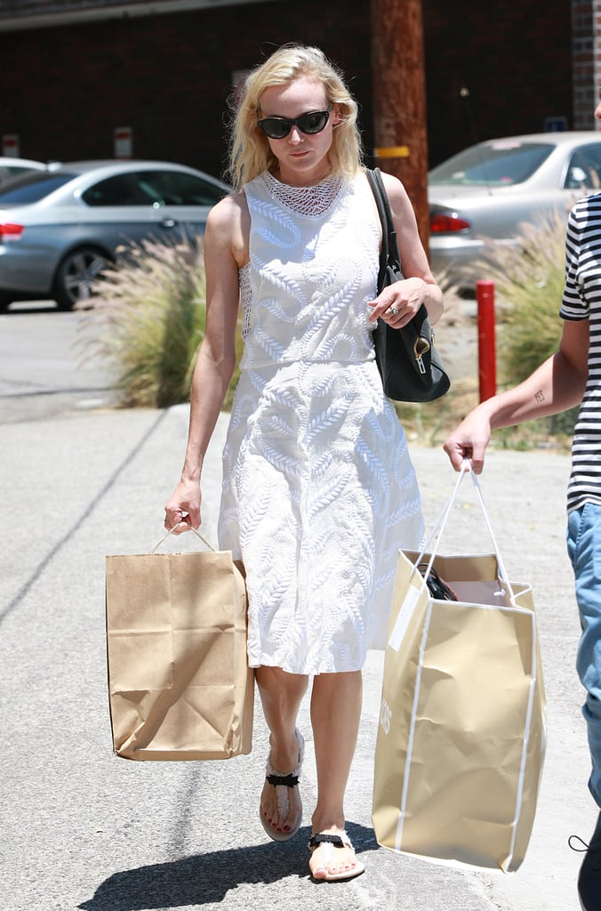 Diane Kruger looked oh-so- stylish in a white knee-length dress and t-strap sandals while running errands around LA.