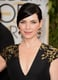Julianna Margulies showcased raven-hued locks wrapped up with champagne-hued eye shadow.