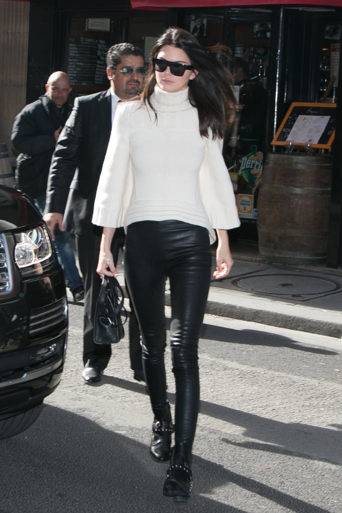 Kendall Jenner made her black-and-white outfit more interesting with textured bottoms and a white billowy turtleneck.
