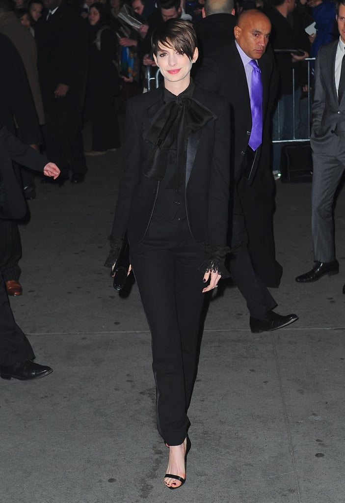 Anne Hathaway's menswear-inspired Saint Laurent Paris look, complete with tuxedo pants and a tie-front blouse, was sweet and sophisticated at the same time. Her Givenchy ankle-strap sandals and Jill Milan clutch were the chicest finishing touches.
