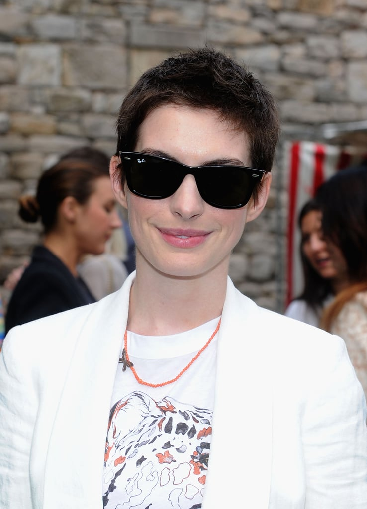 Anne Hathaway showed off her newly short hair at the Stella McCartney presentation in NYC.