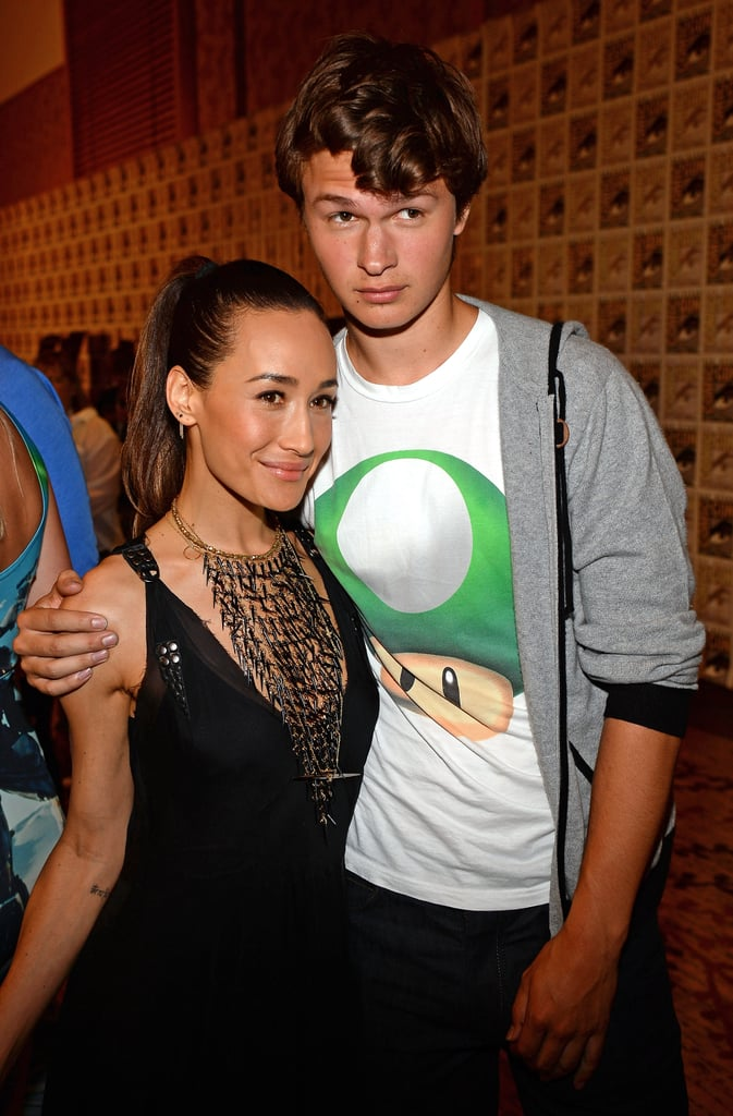 Ansel Elgort hugged Maggie Q at the Divergent press conference in 2013.