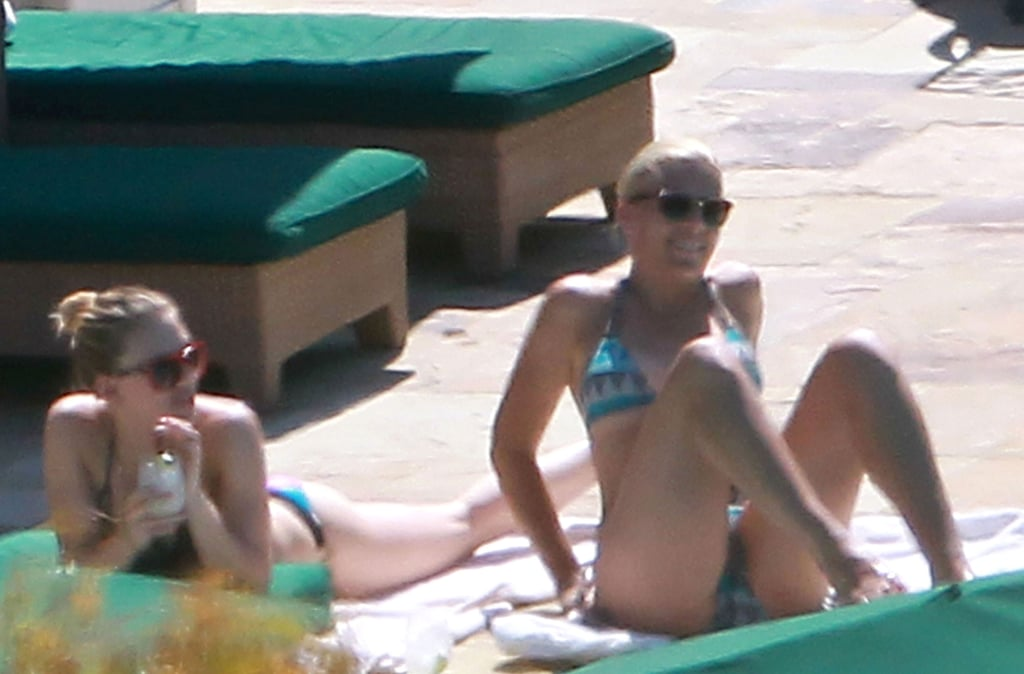 Scarlett Johansson and Busy Philipps lounged by the pool.