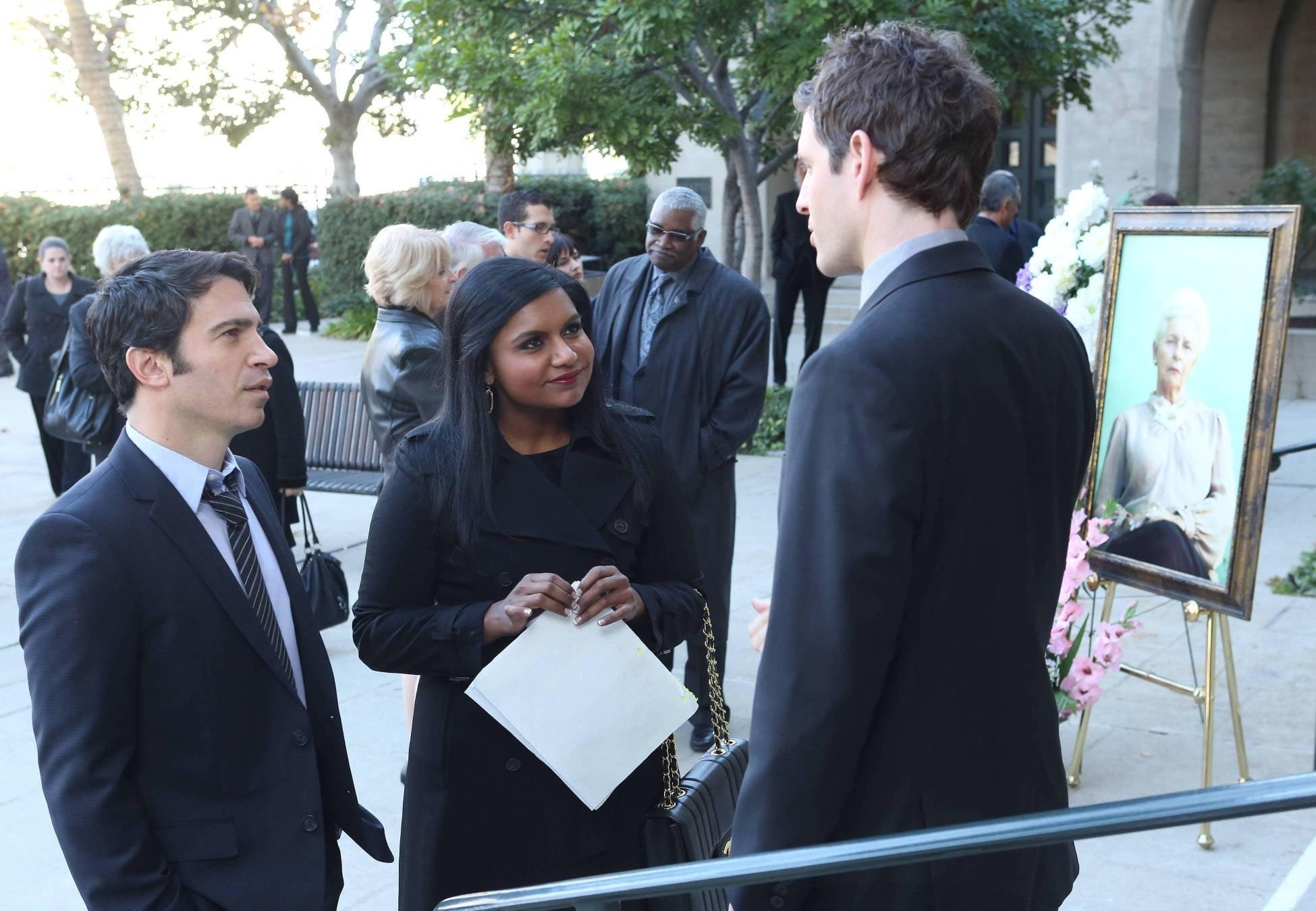 Danny (Chris Messina) and Mindy (Mindy Kaling) attend Cliff's (Glenn Howerton) grandmother's funeral.