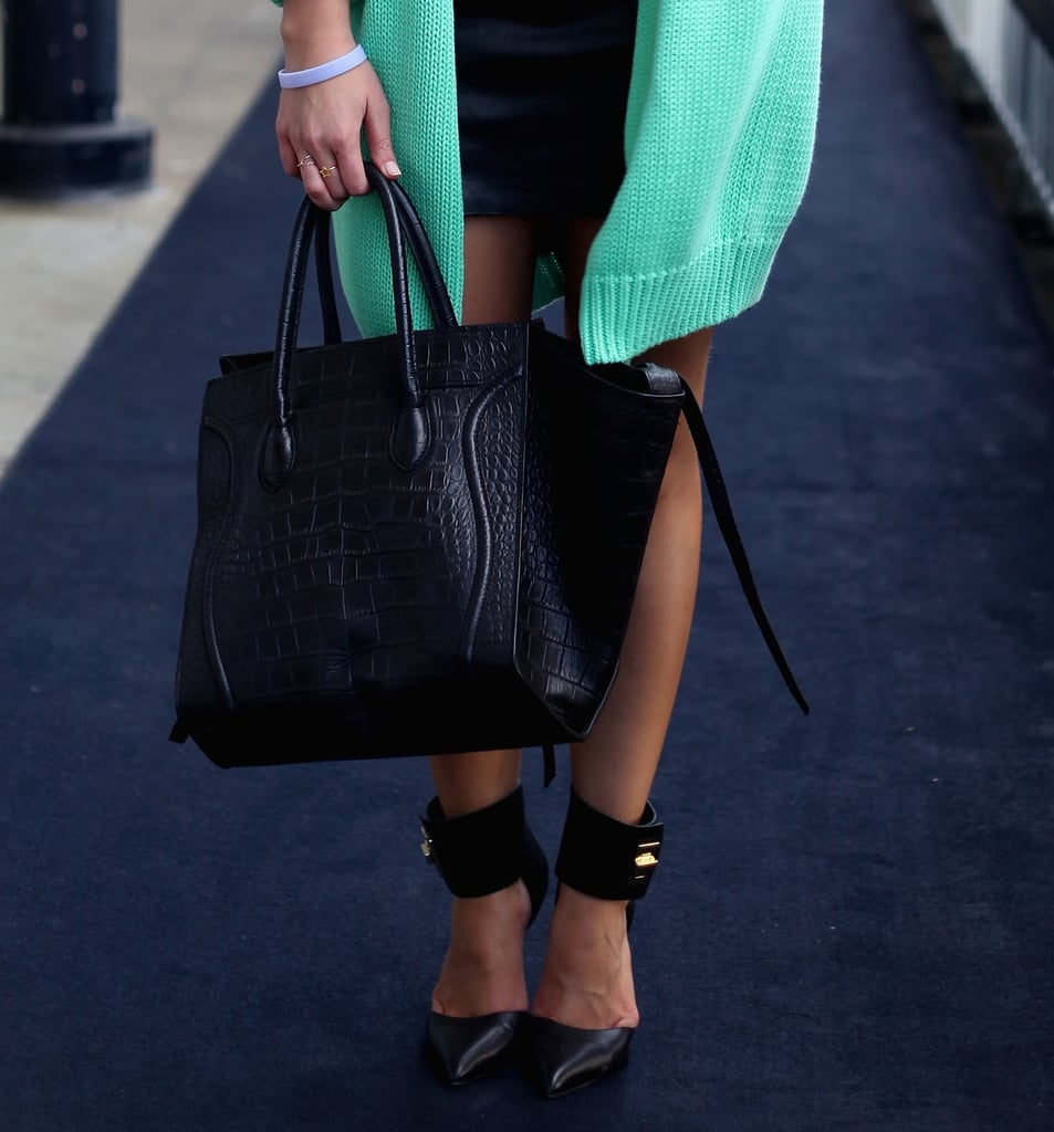But the best styling treat of all? Her reptilian-print Céline luggage tote and wide ankle-strap pumps.