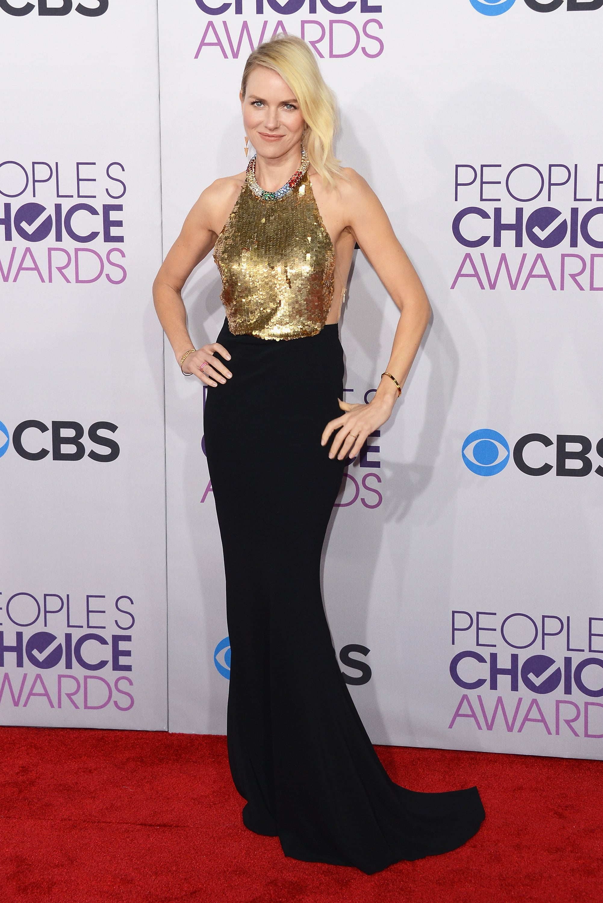 Naomi Watts sparkled in a black and gold gown.