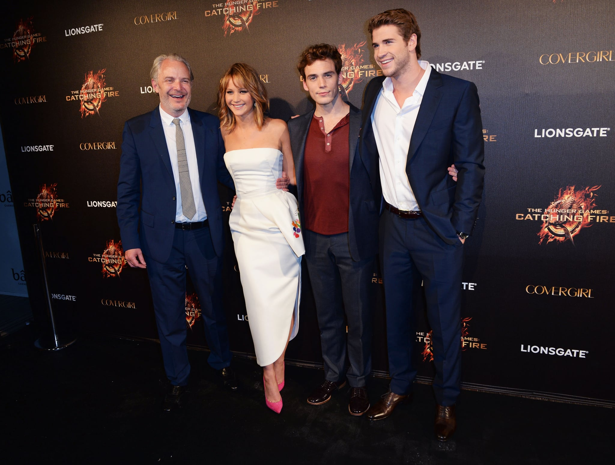 Jennifer Lawrence Stays Glued to Her iPhone at Cannes Catching Fire Bash