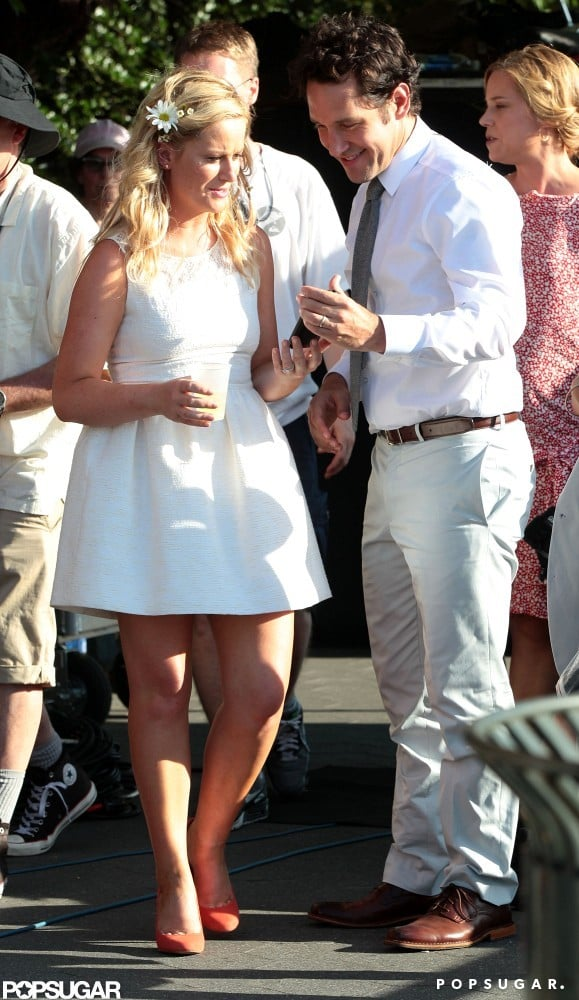 Paul Rudd and Amy Poehler wore coordinating white ensembles for a scene.
