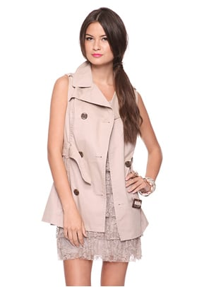 Wear this versatile trench now over a floral print dress and oxfords, and later with a sweater dress, tights, and booties.  Forever 21 Sleeveless Trench ($28)