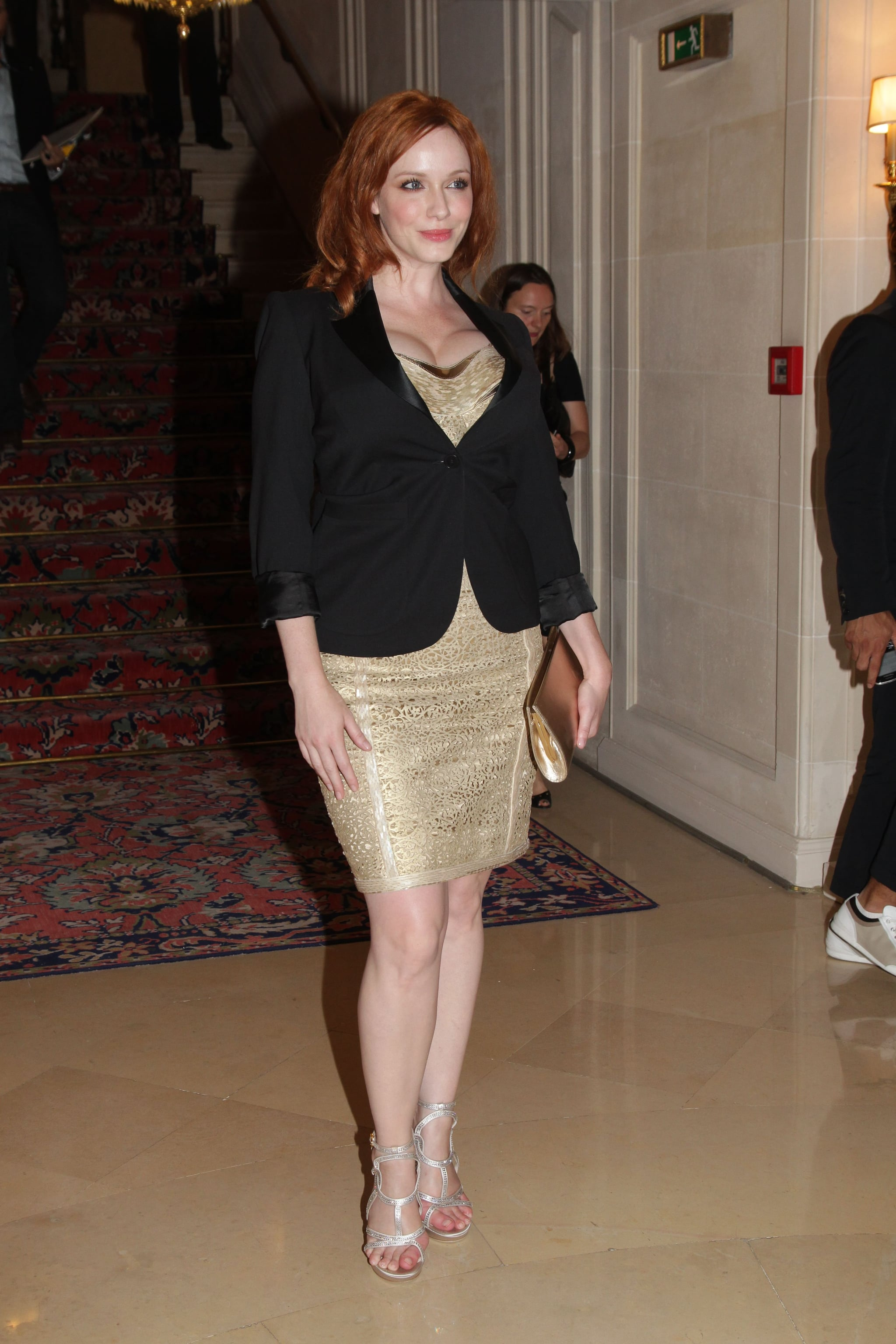 Christina Hendricks posed at the Versace show for Paris Fashion Week.