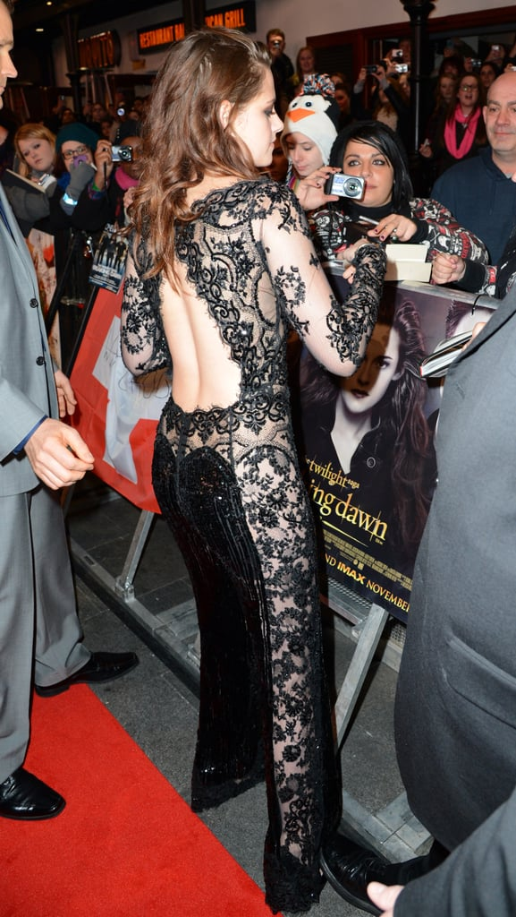 From the side, you can see the pant leg is expertly lace paneled through the middle and adorned with black sequins.