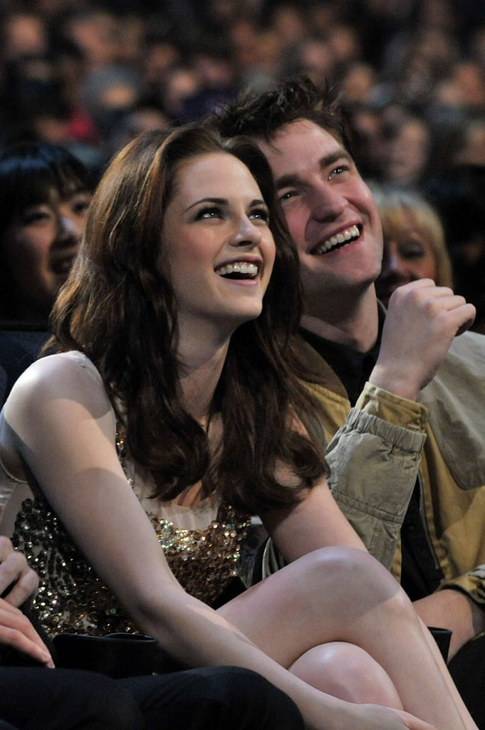 Robert Pattinson and Kristen Stewart sat close and laughed during the 2011 People's Choice Awards.