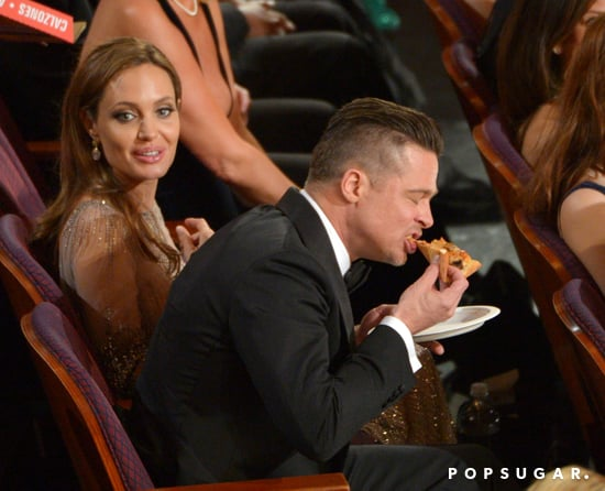 Brad Pitt chowed down on a slice while Angelina Jolie looked on.