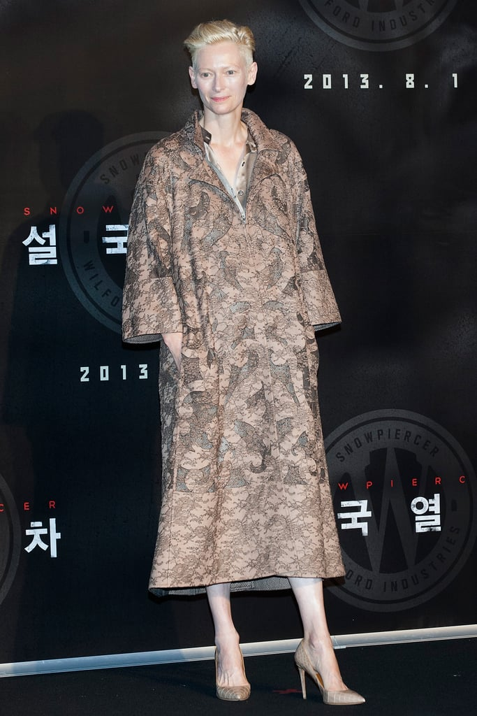 Tilda Swinton greeted fans at a Snowpiercer press conference in a lacy coat from the Valentino Haute Couture collection.