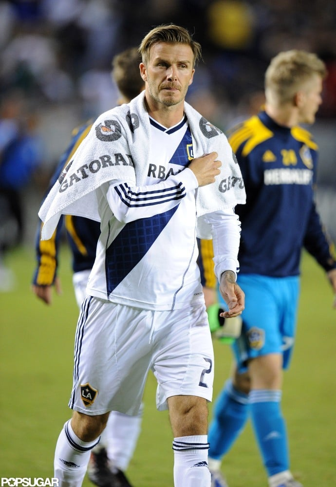 David Beckham wore a towel around his shoulders at his soccer game.