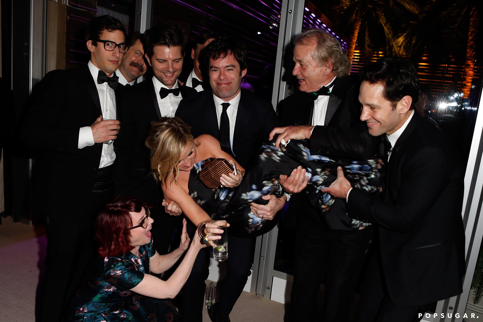 Amy Poehler got a serious lift from some seriously funny friends — Andy Samberg, Nick Offerman, Adam Scott, Megan Mullally, Bill Hader, Bill Murray, and Paul Rudd all tried to carry her during the party!