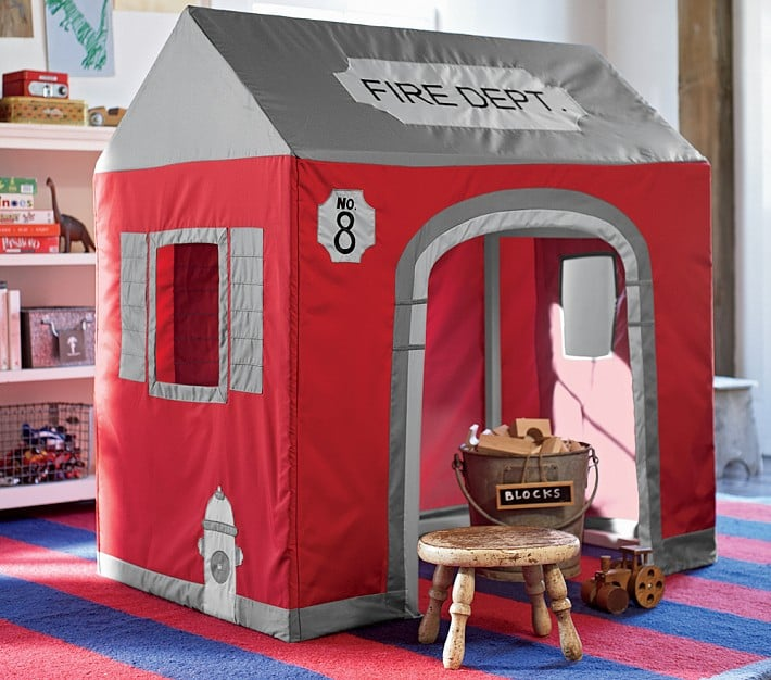 """The rescues and adventures will be endless with this firehouse playhouse ($140, originally $199). The wide station door lets play trucks and fellow """"firefighters"""" move in and out easily."""