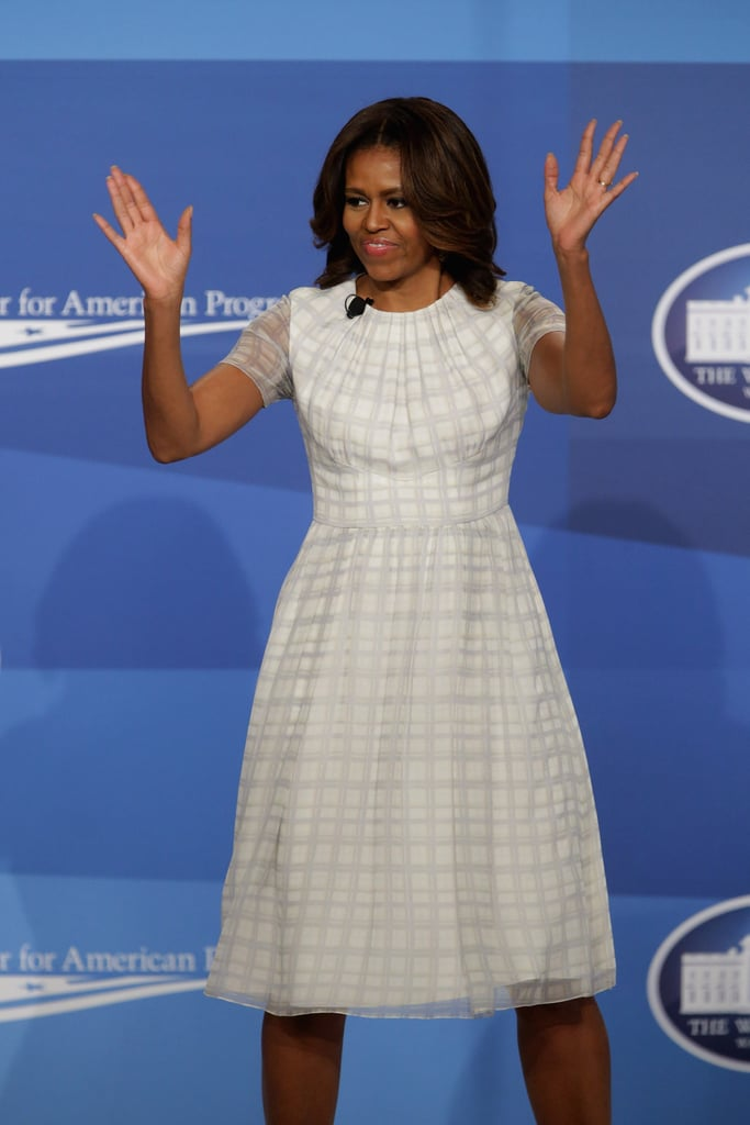 Michelle wore this breezy sheath to participate in the White House Summit on Working Families, proving that it's all about subtlety. Her light lipstick contrasts the subdued, gray checkered print of her frock.
