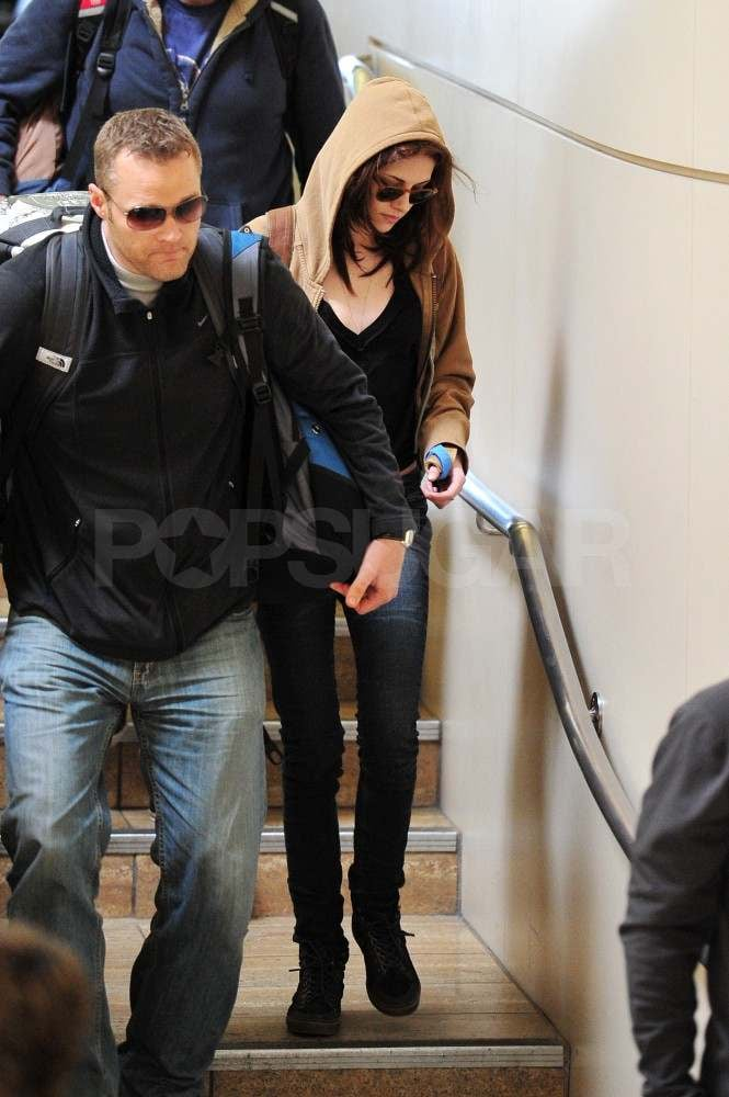 Kristen Stewart Arrives at LAX With Shades on and Her Wrist in a Splint!
