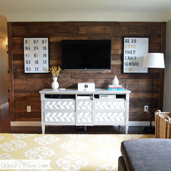 Create a cozy wood wall for just $20. The secret? Shipping pallets.  Source: Cape 27