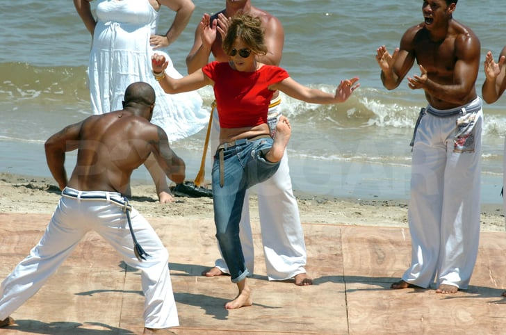 J Lo doing martial arts on the beach.