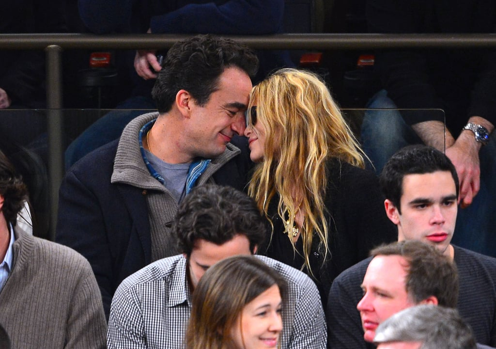 Mary-Kate Olsen and Olivier Sarkozy displayed PDA during the game.