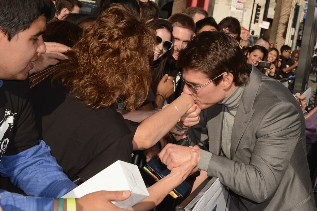 Tom Cruise kissed a fan's hand at the Oblivion premiere in Hollywood.