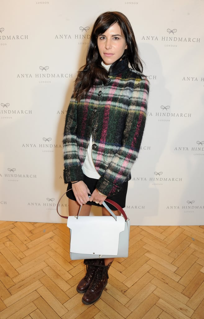 Caroline Sieber layered in a cozy plaid jacket at the Anya Hindmarch runway show.