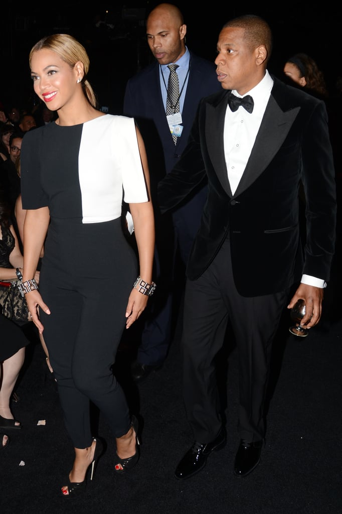 Beyoncé was on trend in a black-and-white Osman jumpsuit and Jay Z was polished in a black tuxedo at the 2013 Grammy Awards.