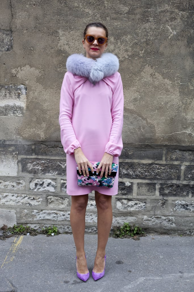 Playing up the season's love of lilac, this style setter wore a fun, furry accessory for a pop of texture.