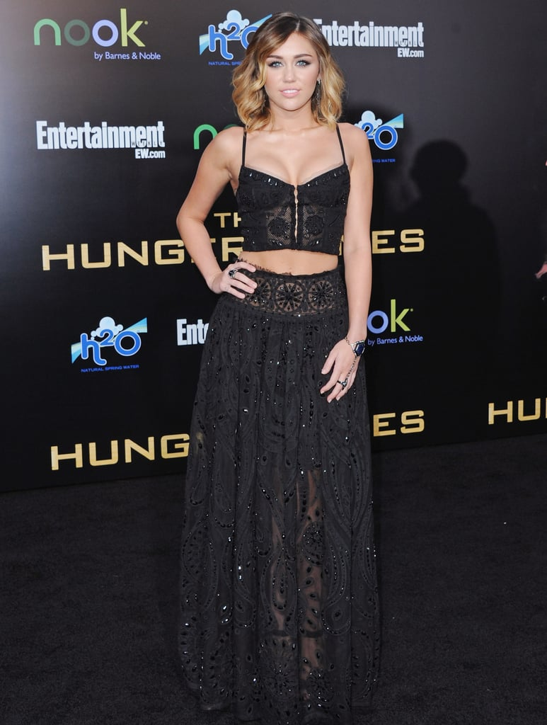 For the LA premiere of The Hunger Games in March 2012, Miley bared her toned midriff in a spaghetti-strap top and floor-length skirt by Pucci. It set the tone for many future ab-baring looks.