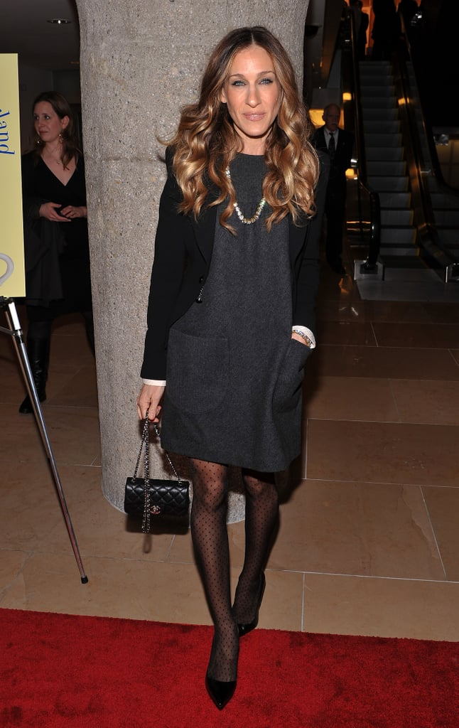 Who says black is boring? SJP layered up in a monochrome look — charcoal tweed box dress, black blazer, polka-dot tights, and patent pumps — for a 2012 Sotheby's book launch in New York City.