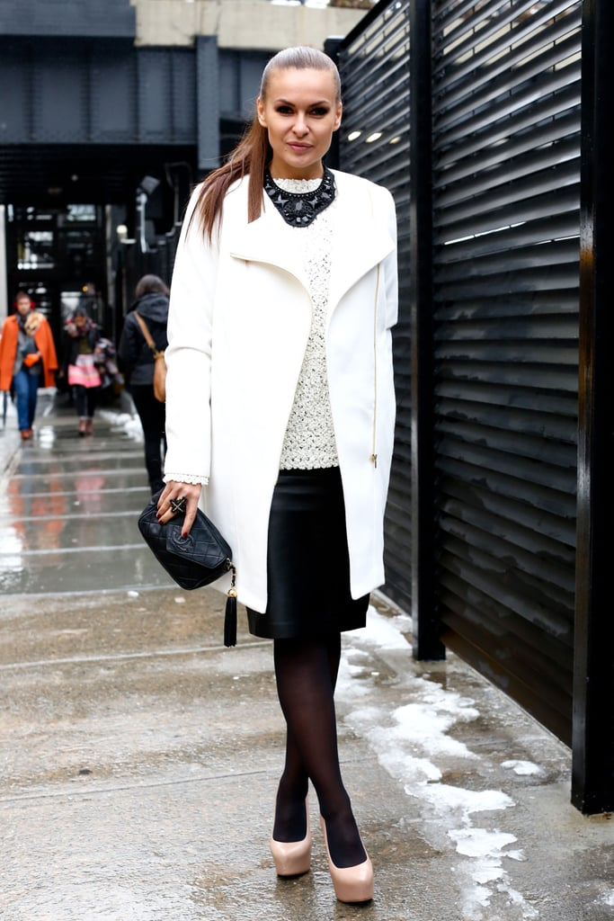 A striking Winter-white coat and sweater meets equally striking jewels.