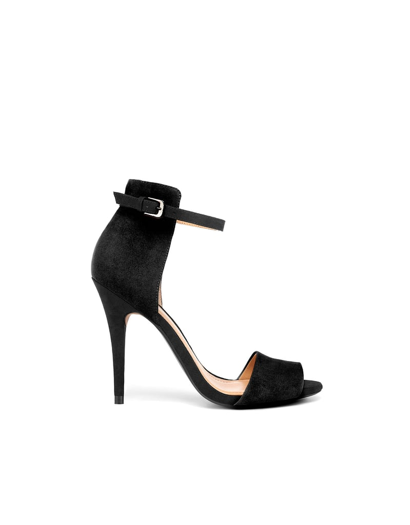 This dressed-up sandal seriously goes with everything, and since they're just $50, you won't feel guilty if they wear out on your travels.  Zara Basic Sandal ($50)
