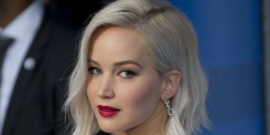Jennifer Lawrence Defies Gravity, Trips At 'X-Men' Red Carpet