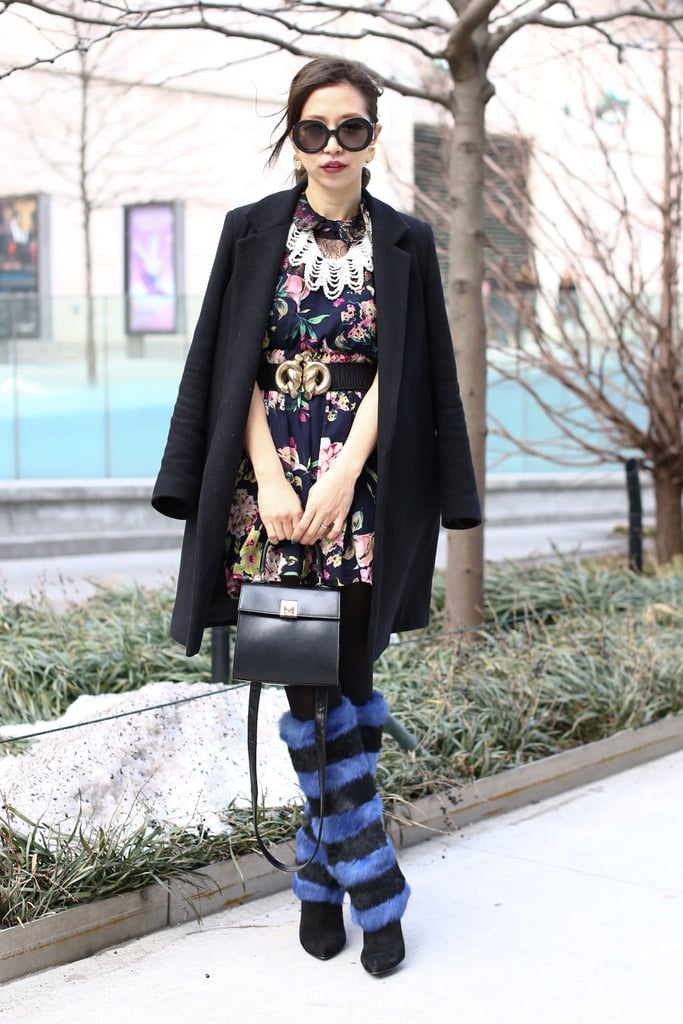 High-impact fur boots furthered this showgoer's outfit whimsy.