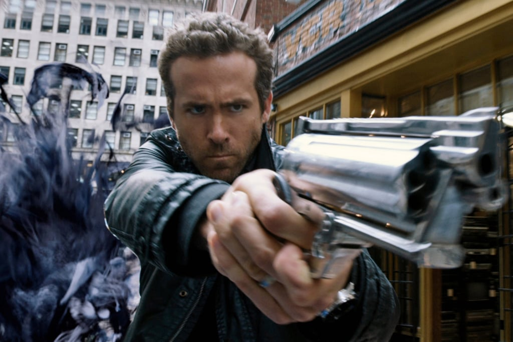 What is that thing behind Ryan Reynolds? Ink monster?