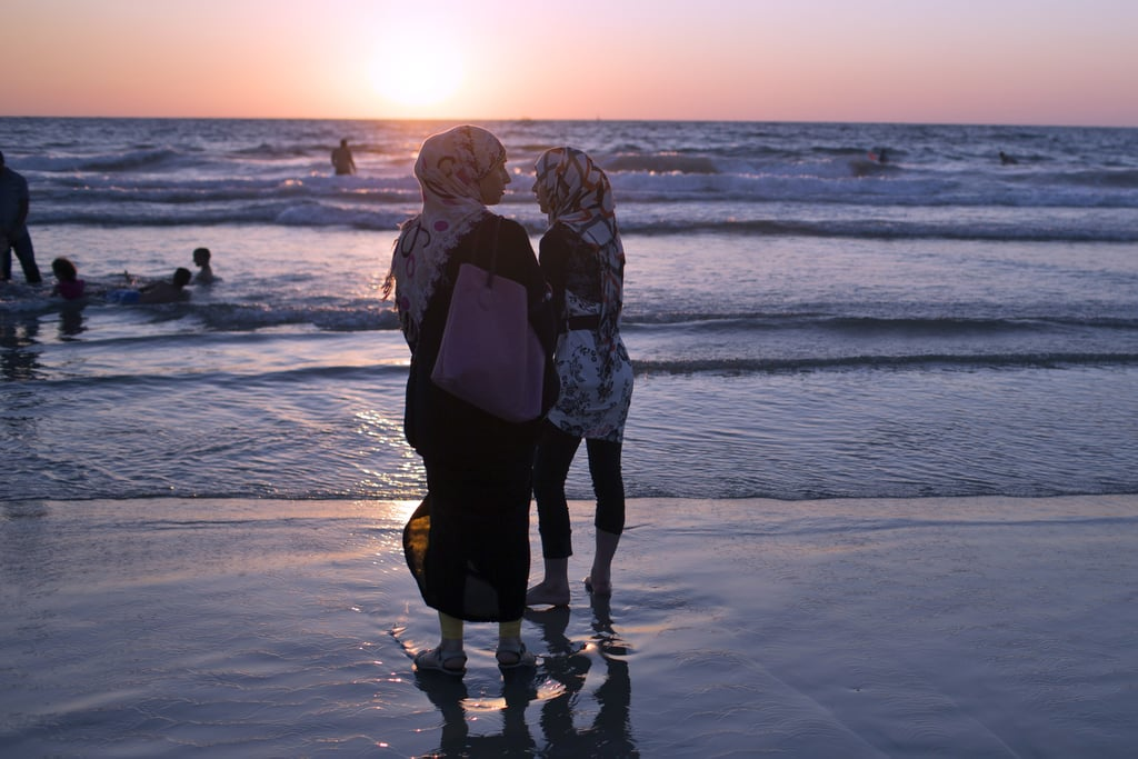 Women in Tel Aviv, Israel, took in the sunset during Eid al-Fitr.