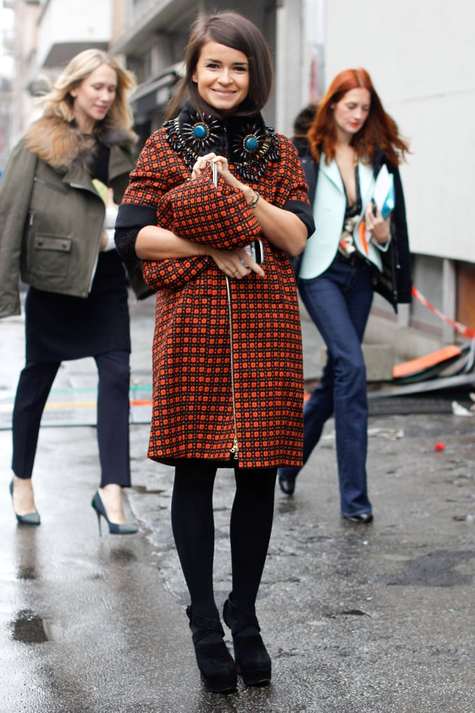 Miroslava Duma was all smiles in high-impact print and bold jewels.