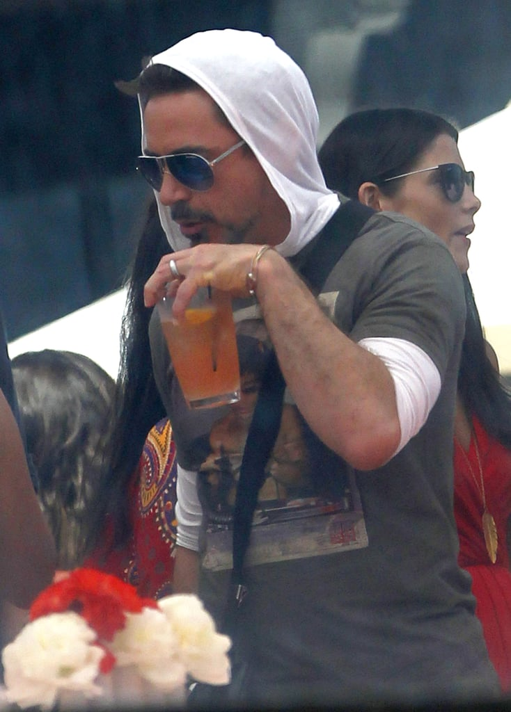 Robert Downey Jr. enjoyed a beverage at Joel Silver's Memorial Day party in LA.