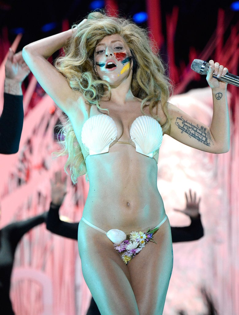 """Lady Gaga stripped to a seashell bra during her performance of """"Applause,"""" which opened the MTV VMAs in 2013."""