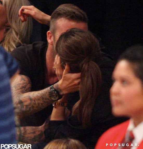 David Beckham and Victoria Beckham kissing.