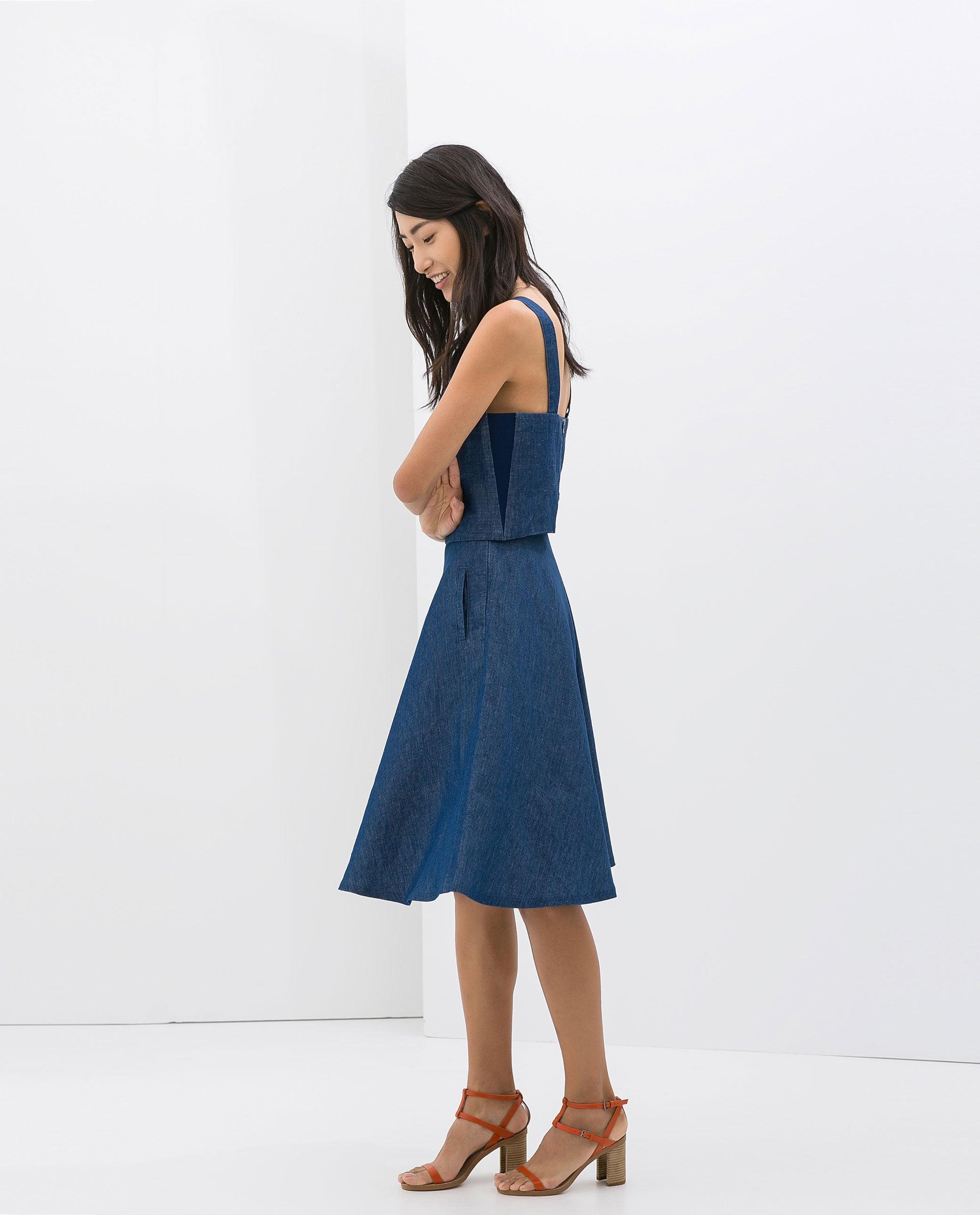 Zara Sleeveless Denim Top ($30) and Denim Midiskirt ($50)