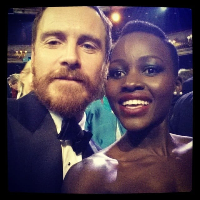 """After Lupita and Michael Fassbender lost in their respective BAFTA categories, they posed for this funny """"losers selfie"""" together. Source: Instagram user lupitanyongo"""