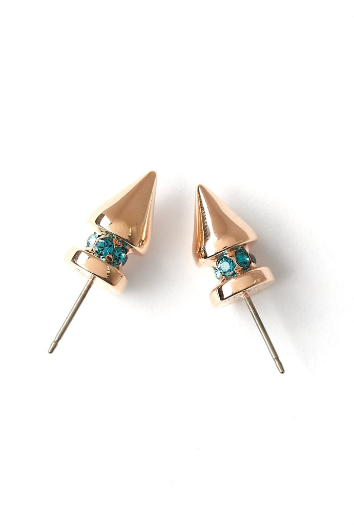 Do simple gold earrings the millennial way with a bit of personality. Mawi's spikes ($186) look dangerously chic up close, but from afar they're demure enough to wear every day.
