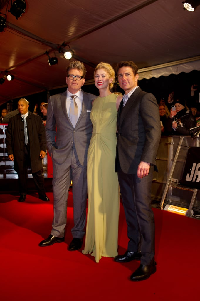 Tom Cruise and Rosamund Pike posed with Christopher McQuarrie.